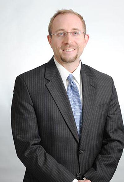 JOHN MCCLIGGOTT, J.D.